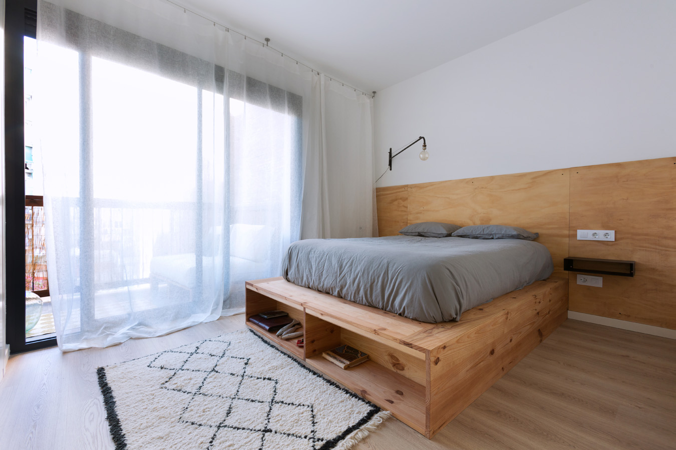 wooden double bed in stylish interior setting