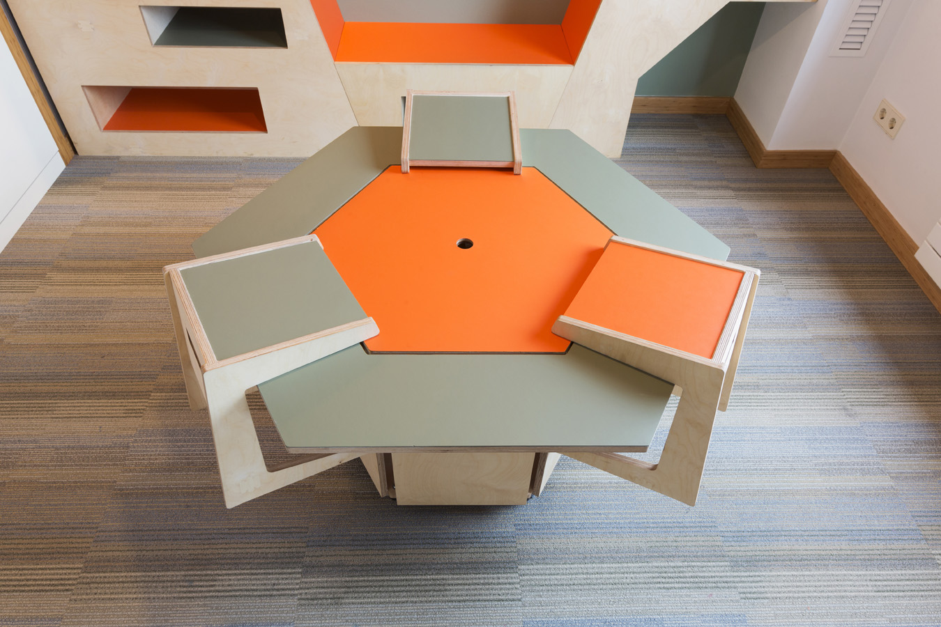 funky table design for kids room, green and orange finish