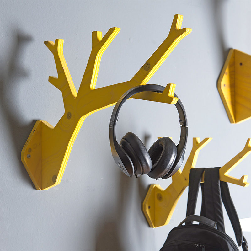 yellow stained wooden tree shaped hanger