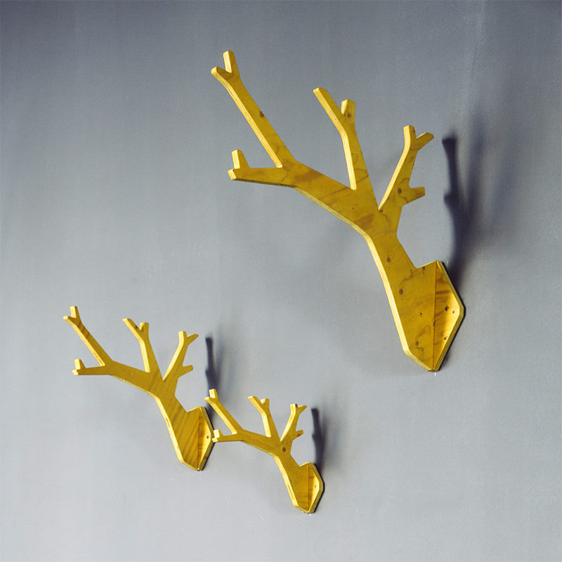 set of 3 wooden tree shaped hanger in yellow stain