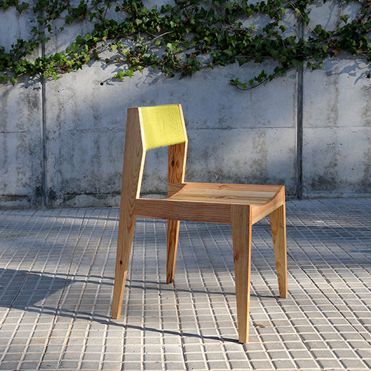 wooden chair with yellow wool backrest