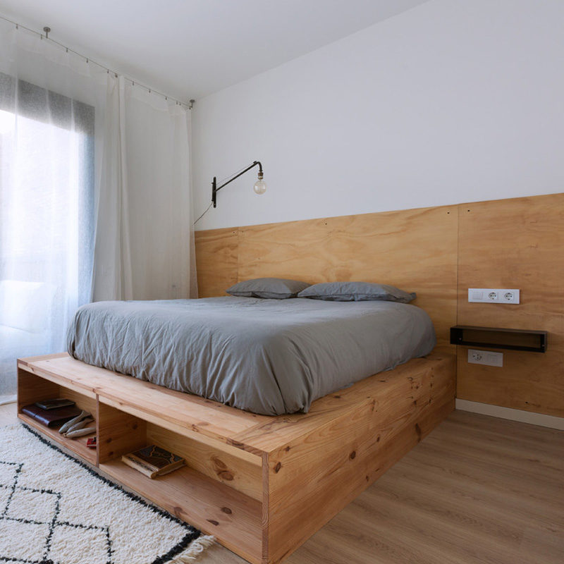 wooden double bed with headboard