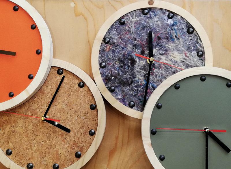 group shot of wooden wall clocks