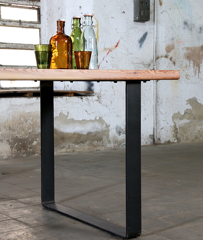 chunky wooden table with steel legs
