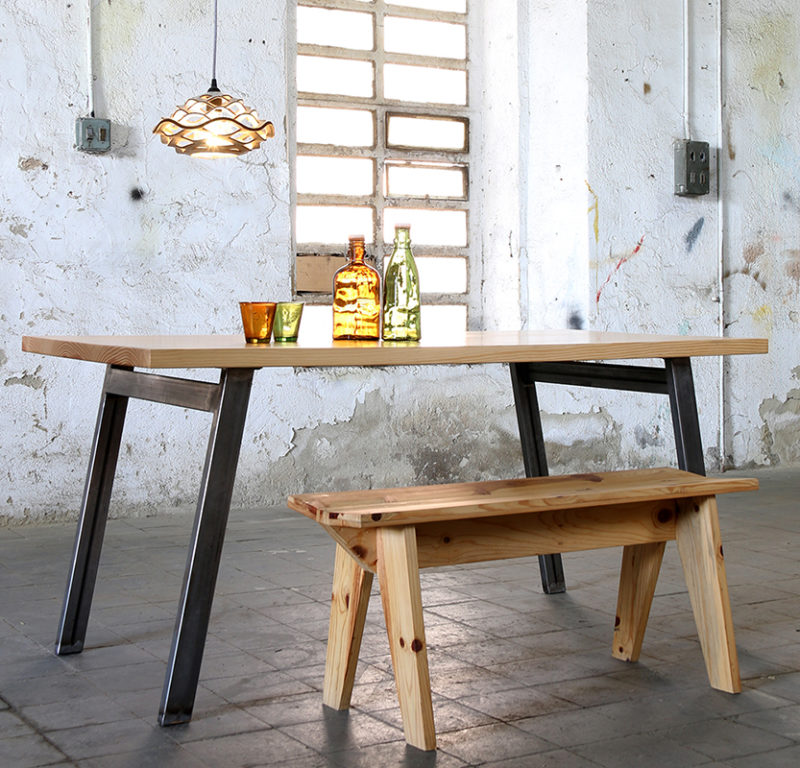 chunky wooden table with steel legs with wooden bench