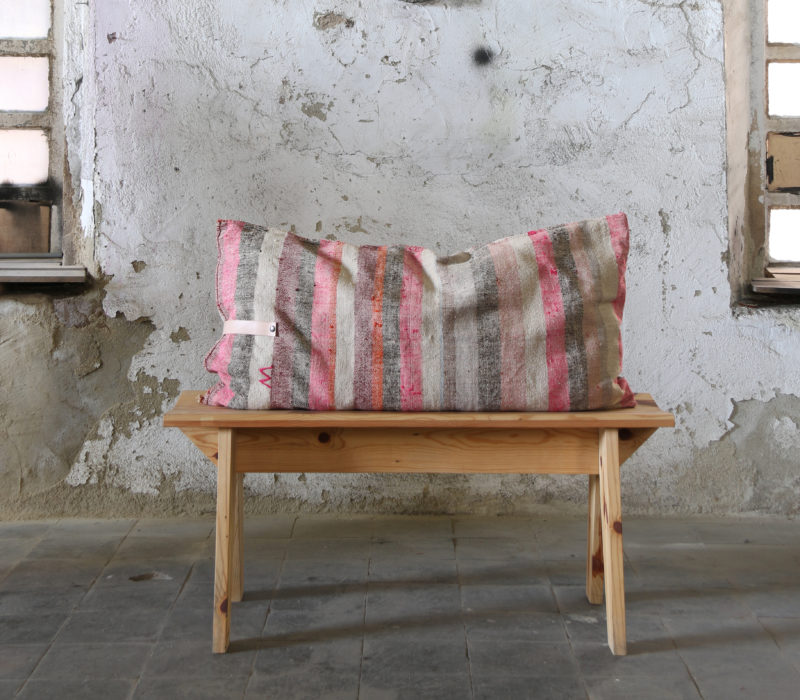 recycled wooden bench with corn sack cushion