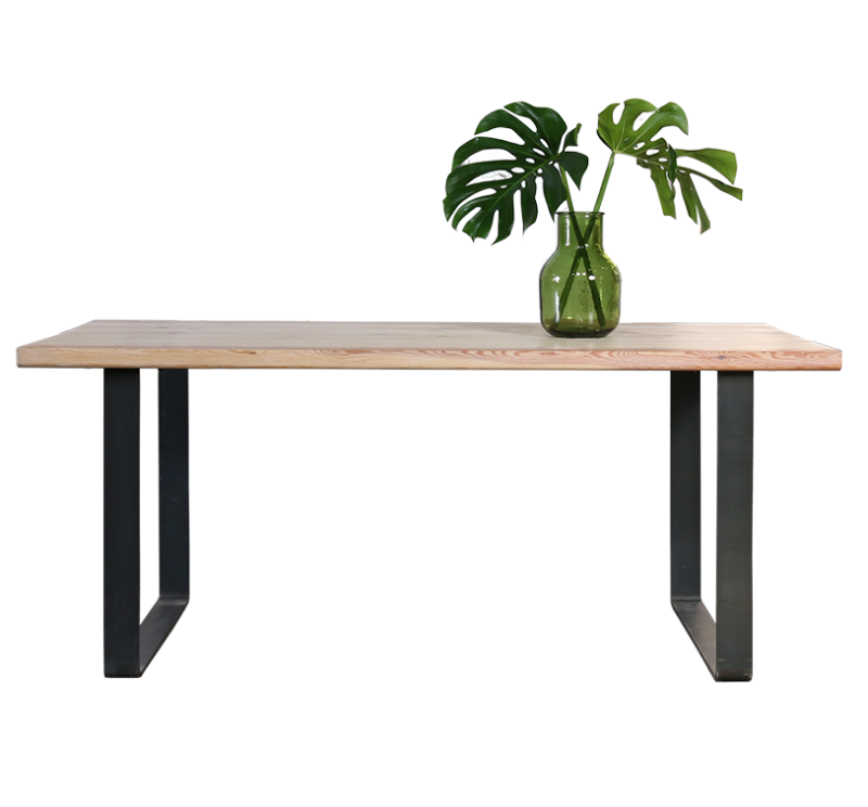 chunky pine wood table with plant