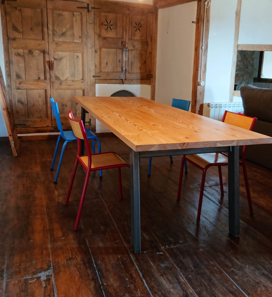 large dining table with vintage chairs
