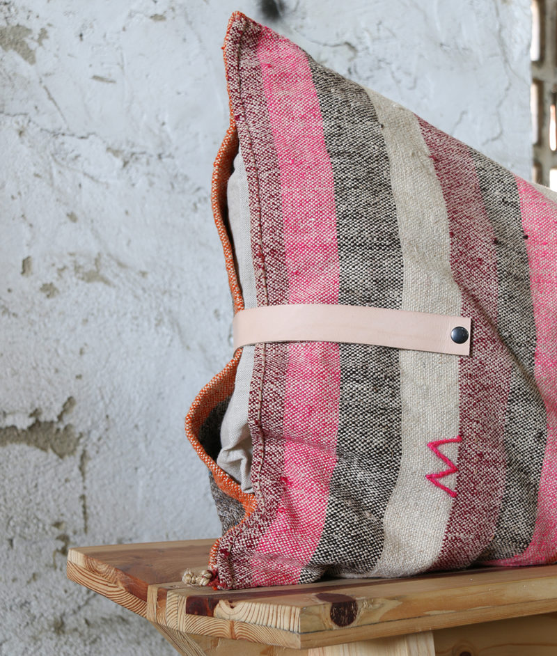 wooden bench with recycled corn sack cushion